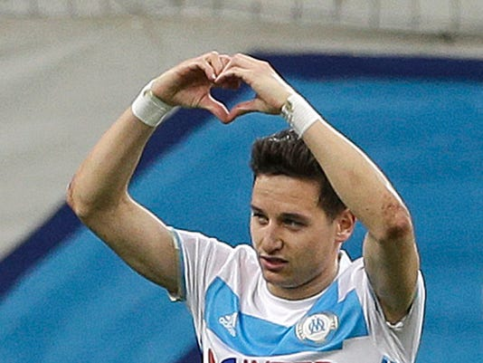 """FILE- In this Friday, March 10, 2017 file photo, Marseille's forward Florian Thauvin, reacts after scoring during the League One soccer match between Marseille and Angers, at the Velodrome Stadium. Getting Marseille back into Europe is a crucial part of American owner Franck McCourt's """"Champions Project """" and his players can take a big step toward that with a good performance away to Bordeaux on Sunday, May 13, 2017. (AP Photo/Claude Paris, File)"""