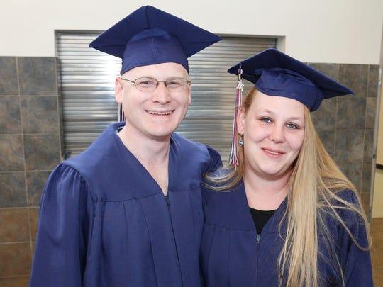 Husband and wife Robert and Tisha Abbott of Westmoreland graduated together.