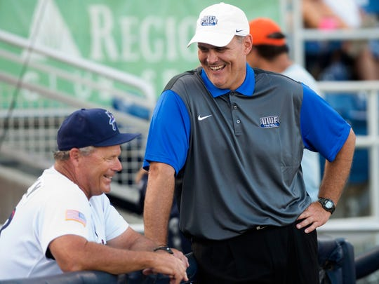 Pat Kelly and UWF football coach Pete Shinnick share a laugh before a Blue Wahoos game last season. The popular Kelly will return for a third season in Pensacola as the team's manager.