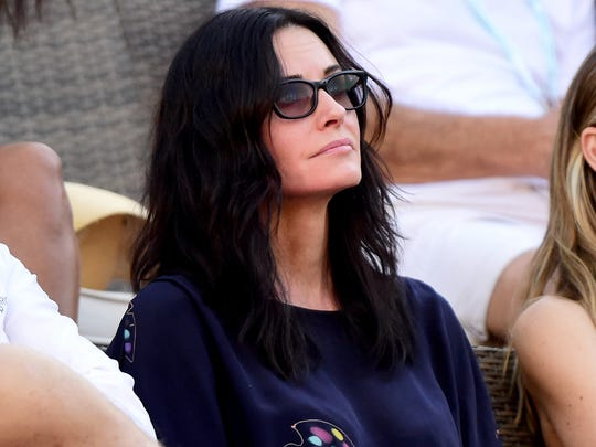 Courteney Cox watches a match between Venus Williams and Jelena Jankovic of Serbia during the BNP Paribas Open at Indian Wells Tennis Garden on March 11, 2017 in Indian Wells.