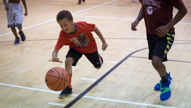 Rontez Darget, 6, breaks away with the ball during the Port Huron Basketball Academy Tuesday, May 24, 2016 at the Leonard Center at Cleveland Elementary School.