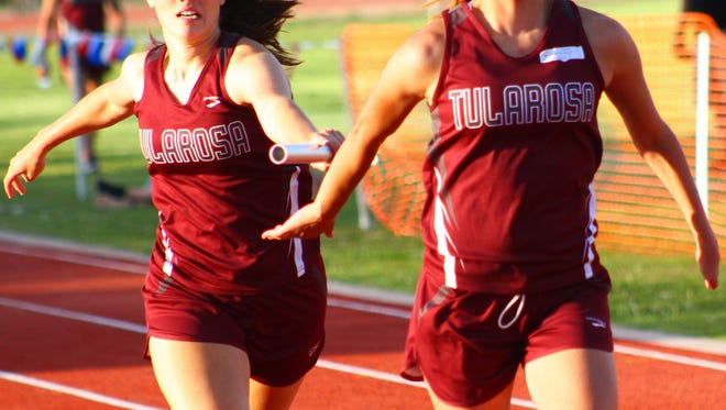 Tularosa senior Gracie Hooten, left, hands off a baton to junior Sierra Montoya during a relay event at the Rose Relays on Friday evening at Bob Cerny Stadium.