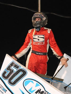 Paul Nienhiser of Chapin, Illinois, celebrates after winning the 25-lap Sprint Invaders feature race Saturday night at 34 Raceway.