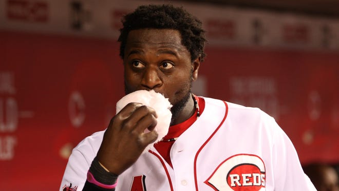 Reds second baseman Brandon Phillips eats cotton candy between innings during a Sept. 24 game against the Mets.