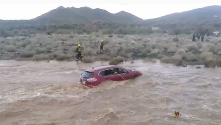 Crews are performing a water rescue in Cave Creek.