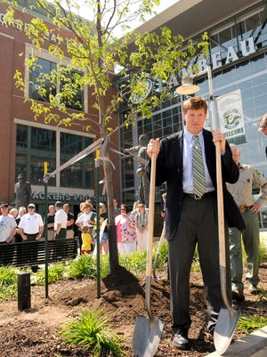 Green Bay Packers president Mark Murphy hands out shovels during the First Down for Trees planting ceremony at Lambeau Field on May 24, 2012.