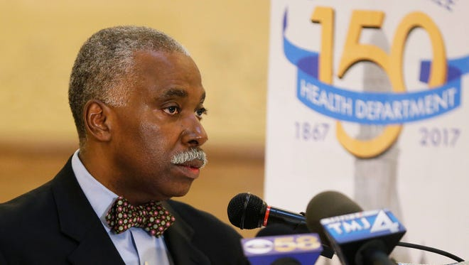 Health Commissioner Bevan K. Baker notes the highlights of the health department during a celebration to commemorate the City of Milwaukee Health Department's 150th anniversary on April 11, 2017. Various guests and former health commissioners were present at the event, which was also used to announce the citywide MKE Elevate Community Health Improvement Plan.