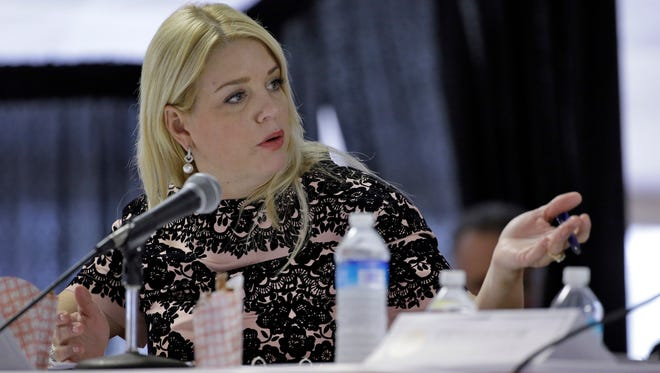 In this Feb. 5, 2015 file photo, Florida Attorney General Pam Bondi speaks in Tampa, Fla. Bondi dropped an inquiry into Donald Trump's troubled Trump University despite complaints from citizens, according to internal documents reviewed by The Associated Press. (AP Photo/Chris O'Meara, File)