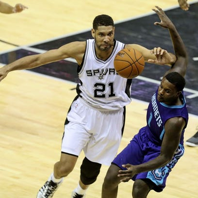 All-Star forward Tim Duncan, chasing down a loose ball in a game against Charlotte this season, has played on all five of the Spurs' championship teams.