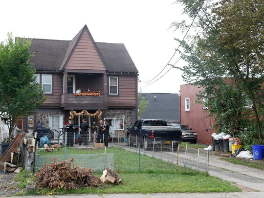 Police served a search warrant at 11 Highland Ave in