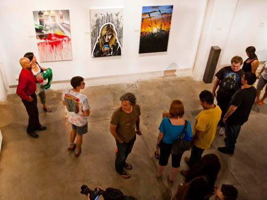 Downtown gallery monOrchid was packed with guests on June 6, 2014 for First Friday on Roosevelt Row in Phoenix.