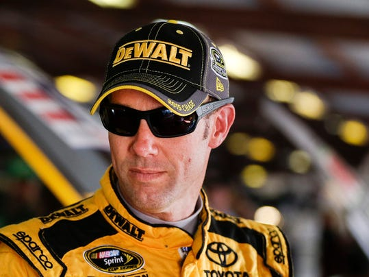 NASCAR Sprint Cup Series driver Matt Kenseth talks with crew members during practice for Sunday's NASCAR auto race at Talladega Superspeedway Friday, Oct. 23, 2015, in Talladega, Ala.. (AP Photo/Butch Dill)