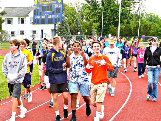 The Delaware Valley High School Relay for Life got off to a drizzly start, but the temperature rose and the sky cleared as the event continued.