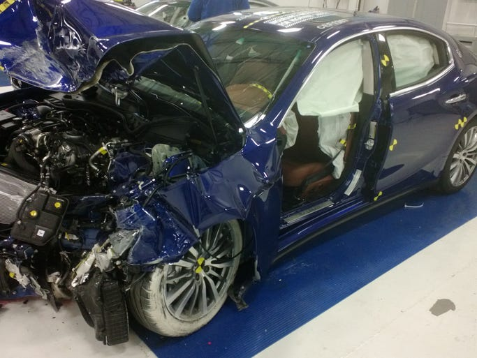 Maserati Ghibli after 'moderate overlap' crash test by the Insurance Institute for Highway Safety. The test slams 40% of the car's width, on the driver's side, into a barrier and measures impact forces on the  crash-test dummy. The car looks terrible, but the passenger compartment is mainly intact, resulting in a good score for protecting the driver.