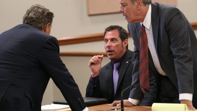 Ex-Inkster police officer William Melendez talks with his attorneys, James Thomas, left, and David Lee, at his preliminary exam in May.