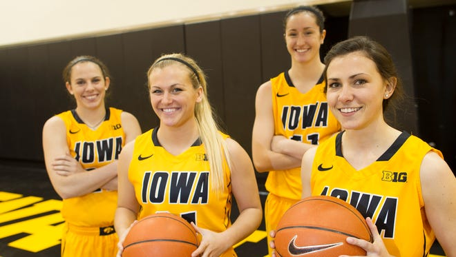 Iowa seniors Samantha Logic, from left, Melissa Dixon, Bethany Doolittle and Kathryn Reynolds pose for a photo during women's basketball media day at Carver-Hawkeye Arena on Thursday, Oct. 30, 2014.  David Scrivner / Iowa City Press-Citizen
