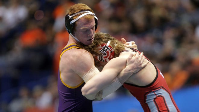 UNI's Cooper Moore wrestles Ohio State's Bo Jordan at 165 pounds in the NCAA Championships quarterfinals at the Scottrade Center in St. Louis, Mo. on Friday, March 20, 2015. Jordan pinned Moore in 3:56. David Scrivner / Iowa City Press-Citizen