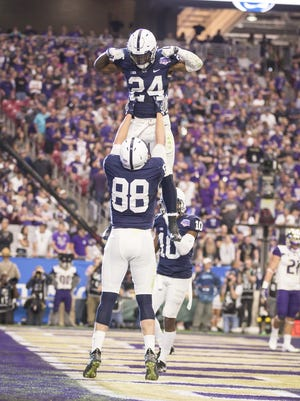 Penn State Nittany Lions tight end Mike Gesicki (88) and running back Miles Sanders (24) celebrate a touchdown during the 47th PlayStation Fiesta Bowl at University of Phoenix Stadium on Saturday, December 30, 2017 in Glendale, Arizona.