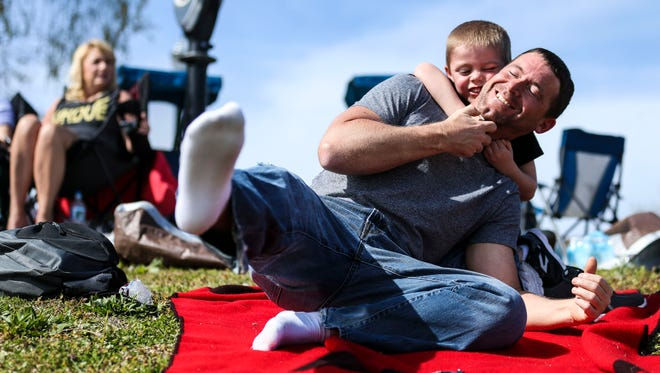 Jarrod Kearby has some fun tussling his son Jaxin, 5, during the Thunder Over Louisville show Saturday. The pair were from Jasper, Indiana. April 21, 2018