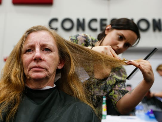 Sharon Kueck, 53, has her hair cut by Stephanie Lockman,