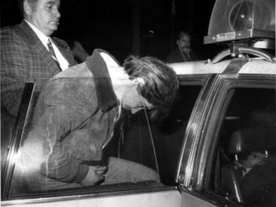 Richard LaBarbera is seen in custody of the Orangetown police after he was charged in the murder of Paula Bohovesky in 1980. LaBarbera will get an early parole hearing this week after a judge voided the state's 2013 rejection.