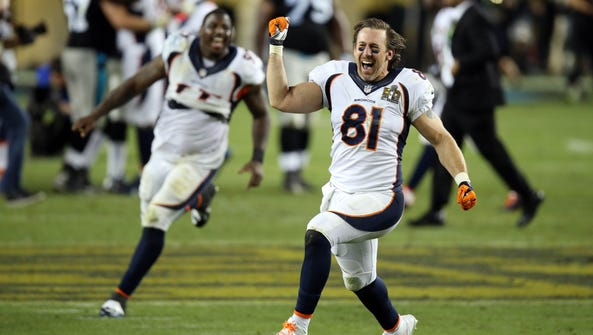 Denver Broncos tight end Owen Daniels (81) celebrates