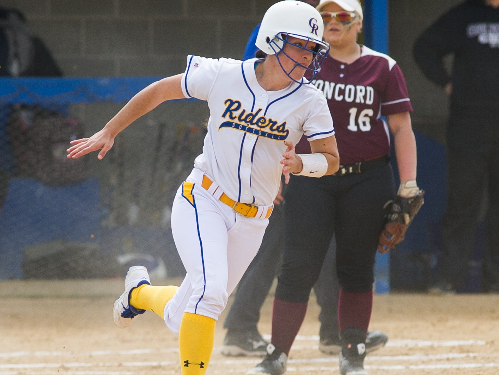 Caesar Rodney's Alexis Howerin (12) runs the bases after hitting for a triple in their game against Concord.