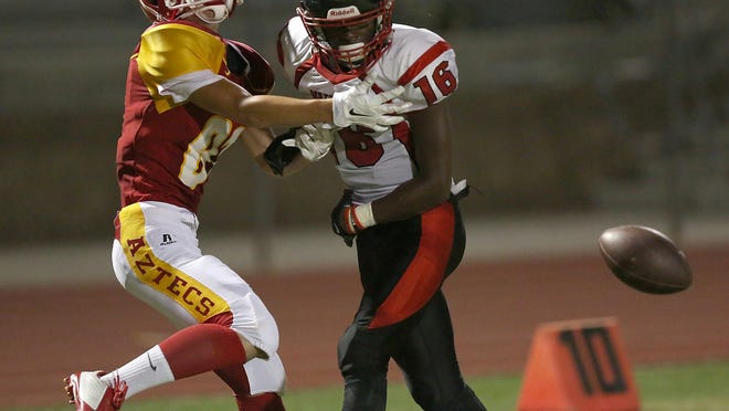 Noah Urretia, left, of Palm Desert is defended by Nathan Boklage of Norte Vista in Palm Desert on Friday.