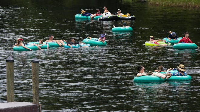 Tubers from the Rainbow Springs State Park make their way down the Rainbow River on July 2 by Marion County's KP Hole Park.