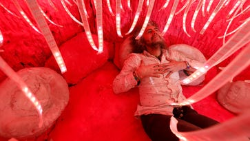 """Wayne Coyne artist and Flaming Lips lead singer inside his sculpture """"The King's Mouth"""" as part of his exhibition at the Waterloo Center for the Arts Wednesday, Feb. 15, 2017, in Waterloo, Iowa."""