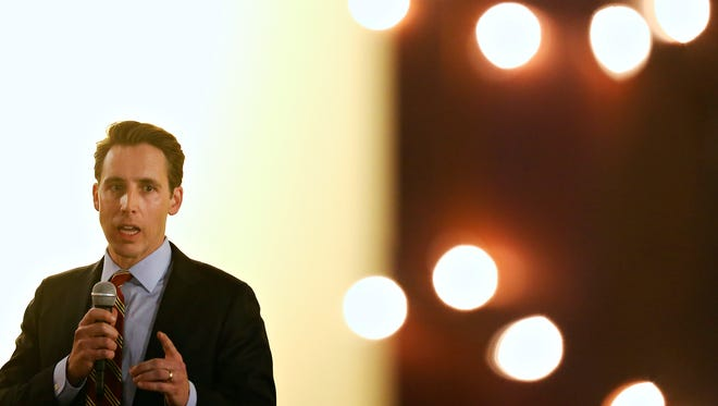 Missouri Attorney General Josh Hawley speaks during a debate between him and the Democratic nominee Teresa Hensley held at Springfield Brewing Company in Springfield, Mo. on Oct. 20, 2016.