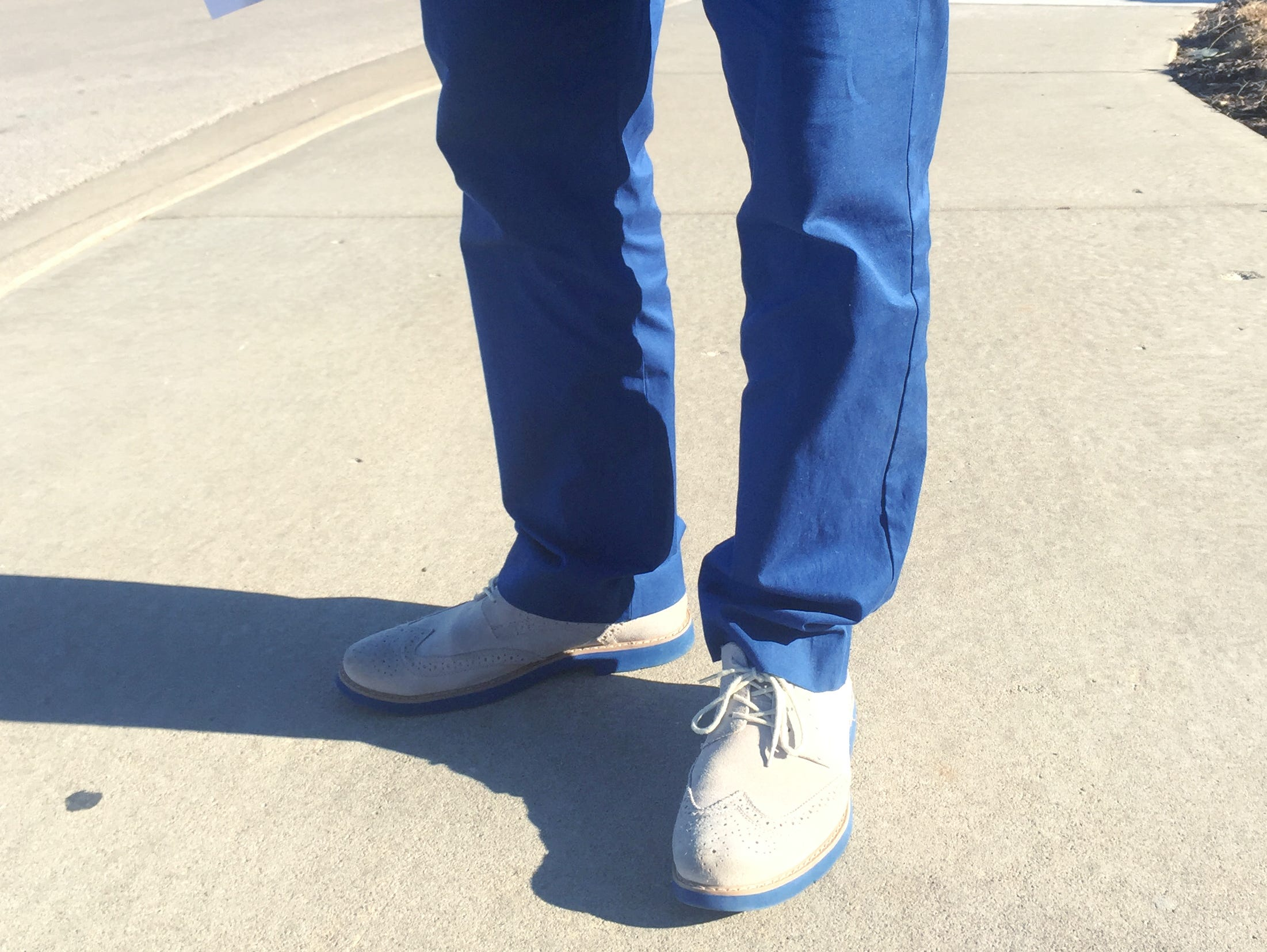 Bolivar boys basketball coach Robby Hoegh has been known to show is Liberator spirit by donning bright blue slacks.