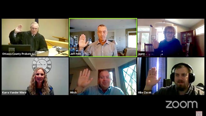 New Court Appointed Special Advocates (CASAs) are sworn in by Ottawa County Probate Court Judge Mark Feyen on Friday, Sept. 18 via Zoom videoconferencing.