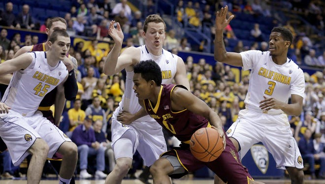 Arizona State's Tra Holder (0) drives the ball against California's David Kravish (45), Dwight Tarwater and Tyrone Wallace (3) during the first half of an NCAA college basketball game Thursday, Jan. 22, 2015, in Berkeley, Calif. (AP Photo/Ben Margot)