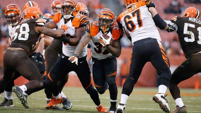 The Cincinnati Bengals running back Jeremy Hill (32) runs the ball in the fourth quarter against the Cleveland Browns at FirstEnergy Stadium. The Enquirer/Jeff Swinger