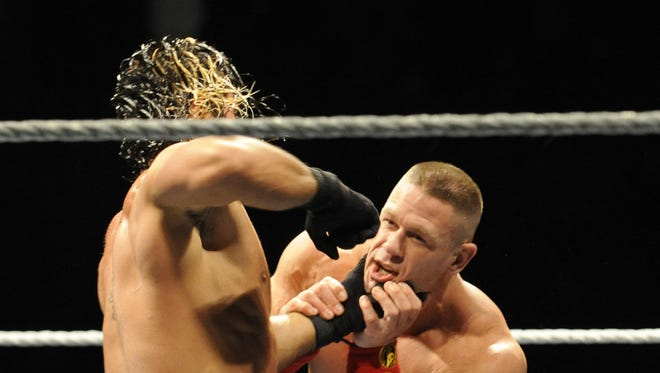 """WWE world heavyweight champion Seth Rollins and United States champion John Cena will battle in a title vs. title match at """"SummerSlam"""" on Sunday."""