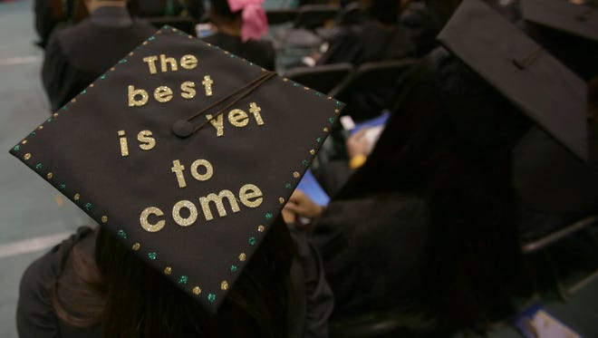 College grads who have trouble paying their student loans might seek an income-driven repayment plan when paychecks are small. The idea is that they'd be able to pay more once they obtain a better-paying job.  Detroit Free Press file photo: Messages on graduation caps at ceremonies at Wayne State University in Detroit in 2016.