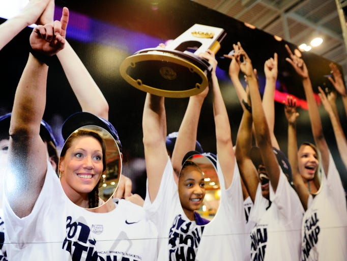 Any Malo and Santana Johnson pose in a championship photo cutout at Tourney Town during  2014 NCAA Women Basketball Final Four at Music City Center on Saturday April 5, 2014.