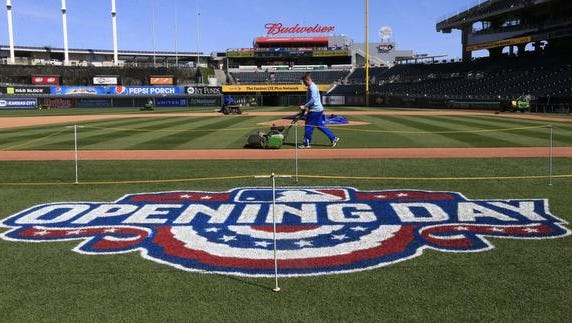 Grounds crew members prepare for the field at Kauffman Stadium in Kansas City, Mo., Saturday, April 2, 2016, for Sunday's opening day baseball game between the New York Mets and Kansas City Royals.  (AP Photo/Orlin Wagner)