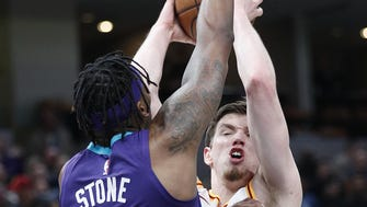 Indiana Pacers forward T.J. Leaf (22) is fouled by Charlotte Hornets guard Julyan Stone (32) in the first half of their game at Bankers Life Fieldhouse on Tuesday, April 10, 2018.