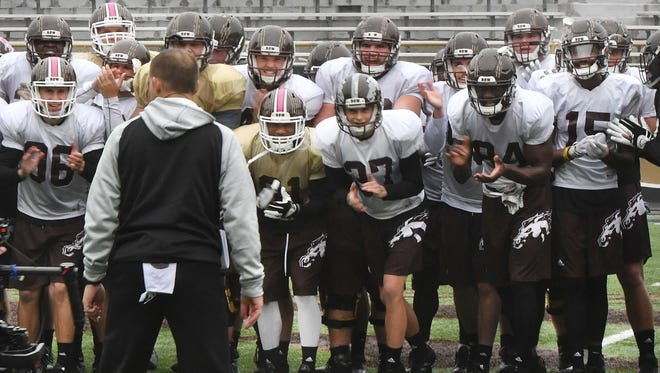 Western Michigan coach P.J. Fleck gets his players revved up as they finish a good morning of practice.