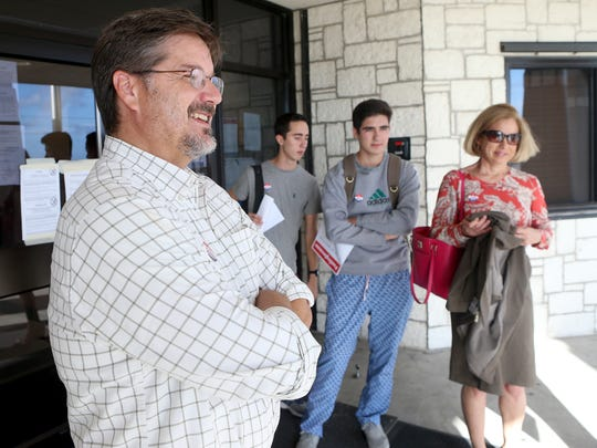 Craig Henderson (left) talks about celebrating his birthday and voting with his children Brady Henderson, Cormac Henderson and Abarrane Henderson on Tuesday, Nov. 1, 2016, at London High School in Corpus Christi.
