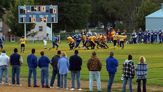 An archive photo from a nine-man football game.
