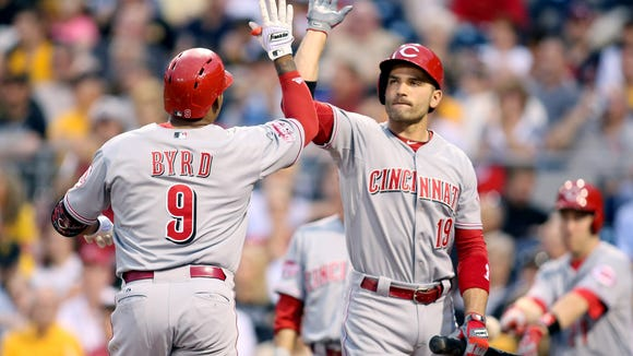 Reds left fielder Marlon Byrd (9) receives a high-five from first baseman Joey Votto after Byrd hit a two-run home run against the Pittsburgh Pirates during the third inning Tuesday at PNC Park.