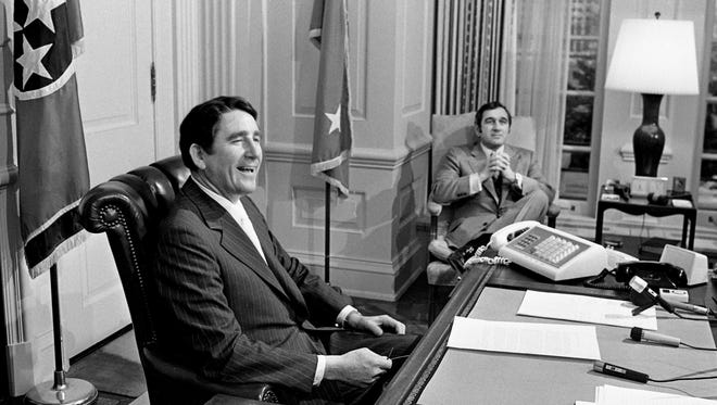 Gov. Winfield Dunn, behind his desk in the executive office of the state Capitol, confers with Gov-elect Ray Blanton during a 45-minute visit Dec. 19, 1974.