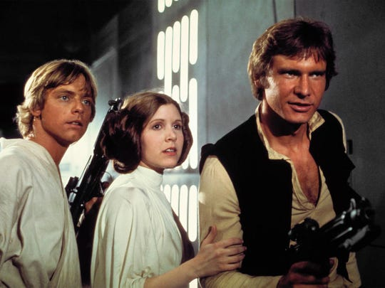 "Luke Skywalker (Mark Hamill), Princess Leia (Carrie Fisher) and Han Solo (Harrison Ford) escape from the Death Star in ""Star Wars: Episode IV A New Hope."""