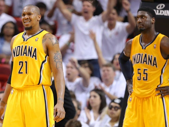 David West (21) and Roy Hibbert (55) react to a play called during Game 6 of the Eastern Conference Finals inside American Airlines Arena, May 30, 2014, in Miami, Fla.