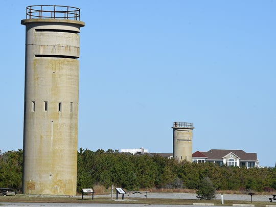 This 2016 file photo shows two of the World War II coastal defense towers located in Delaware Seashore State Park.