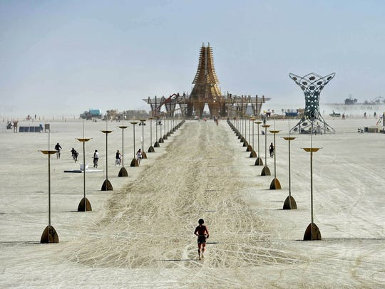 Burning Man 2017 A burner runs toward The Temple at