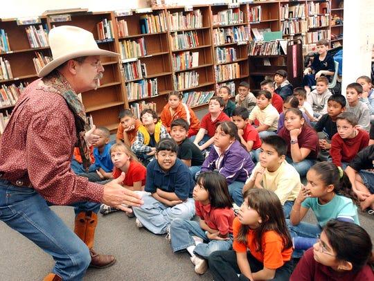 Professional storyteller Lloyd Shelby tells cowboy
